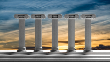50948244 - five ancient pillars with sunset sky background.