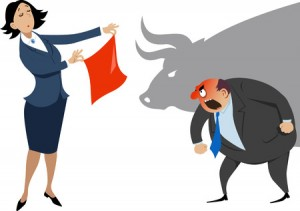 67307586 - businesswoman showing a red handkerchief to an enraged businessman, a shadow of a bull on the background